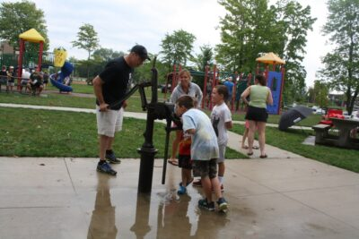 Kids Drinking from Water Pump
