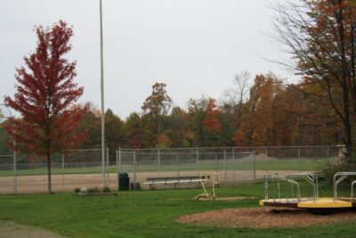 Bench and Spinner Near the Baseball Field